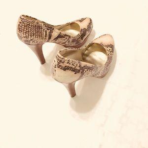 Snake skin high heel pumps